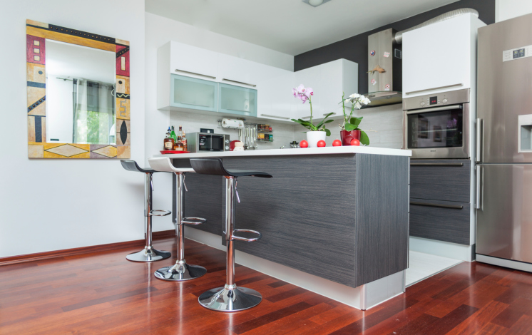 Elegant Grey And White Small Kitchen With Rich Hard Wood Flooring