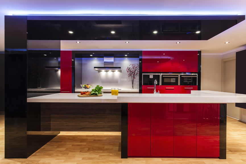 Ultra modern kitchen with blue lighting and deep red cabinets