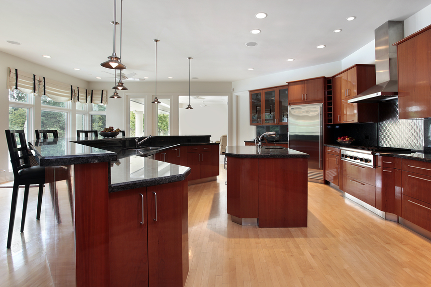 Unique Red Cabinets with Black Countertops