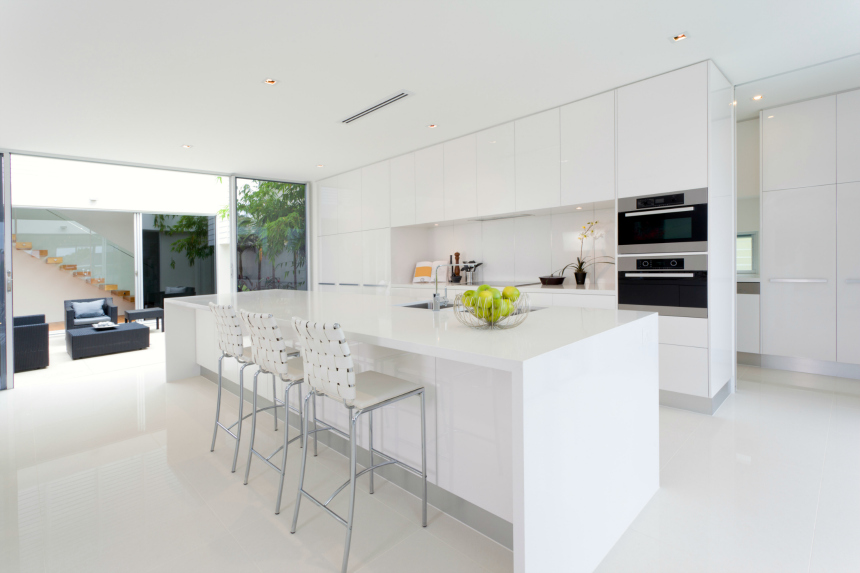 All White Modern Kitchen With Large Long Island With Bar Stools